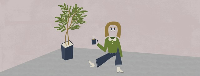 a woman who is half invisible is sitting on the ground and holding a cup of coffee