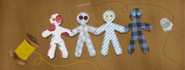 Fabric people cut outs stitched together surrounded by a thimble and spool of thread.