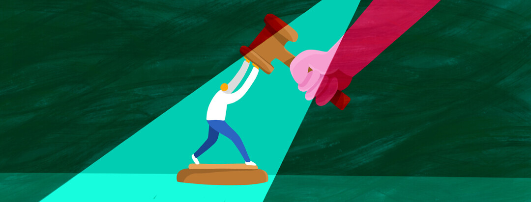 A person stands on a podium and pushes against a gavel being brought down by a giant hand