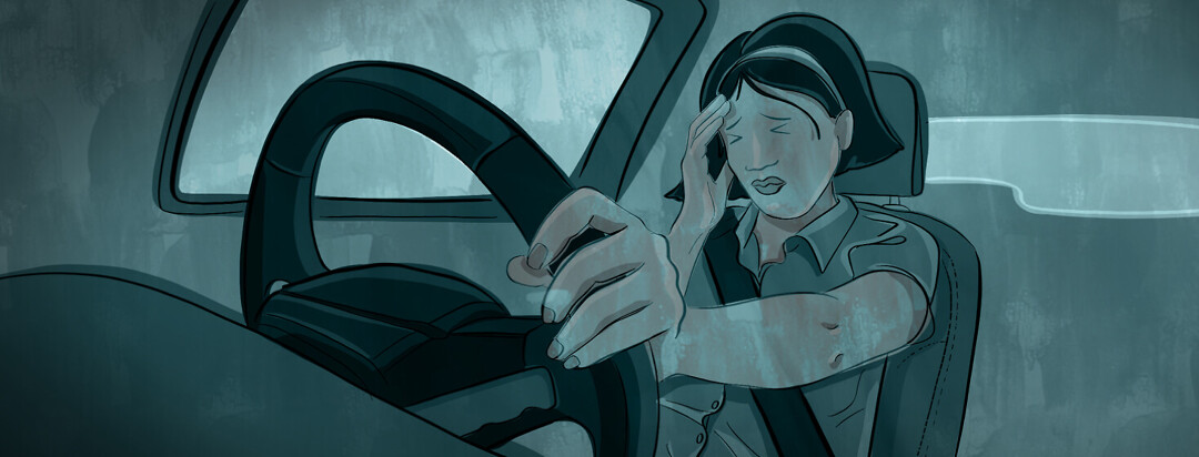 a woman behind the wheel of a car puts her hand to her head while her eyes are closed