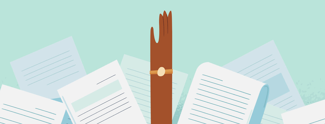 An overwhelmed hand reaching up for help through a pile of paperwork